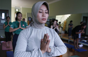 Muslim woman practicing yoga.